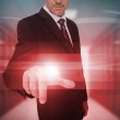 Stock Photo: Businessmtouching futuristic red light touchscreen