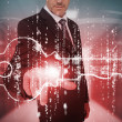 Businessman selecting futuristic key graphic — Stock Photo