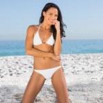 Cheerful sexy woman in white bikini posing — Stock Photo #29464815