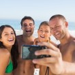 Cheerful friends taking pictures of themselves — Stock Photo #29464821