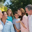 Stock Photo: Smiling family and grandparents talking
