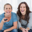 Stock Photo: Laughing women watching television