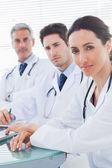 Doctors looking at camera — Stock Photo