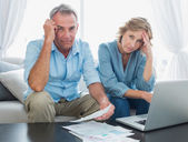 Anxious couple paying their bills online with laptop — Foto Stock