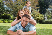 Happy family members lying on each other — Stock Photo