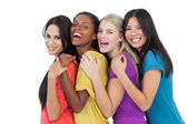 Diverse young women laughing at camera and embracing — Stock Photo
