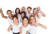 Positive female models smiling at camera — Stock Photo