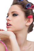 Thoughtful model with hair curlers — Stock Photo
