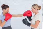 Brown haired businesswoman punching her blond colleague during b — Stock Photo