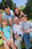 Multi generation family looking at photos — Stock Photo