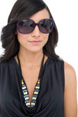 Elegant dark haired model wearing sunglasses — Stock Photo