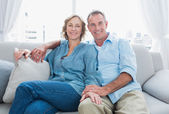 Middle aged couple relaxing on the couch — Stock Photo