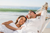 Peaceful couple napping in a hammock — Stock Photo