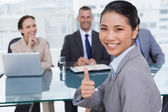 Young applicant giving thumb up after obtaining the job — Stock Photo