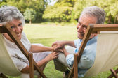 Happy mature couple smiling at camera — Stock Photo