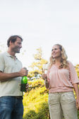 Beautiful couple having champagne together — Stock Photo