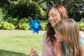 Mother with daughter with a pinwheel in the park — Stock Photo