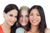 Diverse young women smiling at camera — Stock Photo
