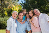 Smiling family and grandparents in the countryside — Stock Photo