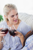 Friends toasting with red wine together — Stock Photo