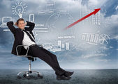 Confident businessman reclining in swivel chair in front of mark — Stok fotoğraf
