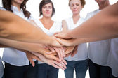 Relaxed women joining hands in a circle — Stock Photo
