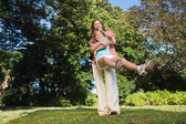 Mother swinging her daughter around having fun — Stock Photo