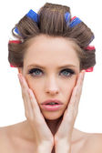 Sensual model with hair curlers — Stock Photo