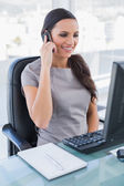 Cheerful gorgeous businesswoman on the phone — Stock Photo
