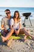 Cheerful couple posing while having barbecue — Stock Photo