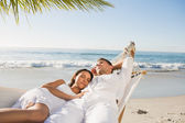 Calm couple napping in a hammock — Stock Photo