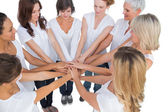 Peaceful female models joining hands in a circle — Stock Photo