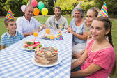Extended family celebrating little girls birthday outside at pic — Stock Photo