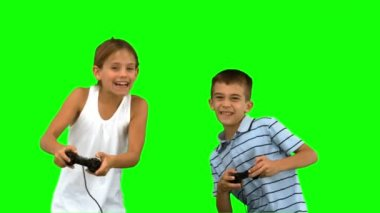 Siblings playing video games on green screen — Stock Video