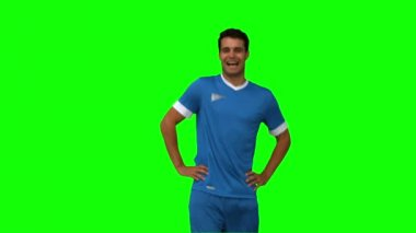 Football player warming up on green screen — Stock Video