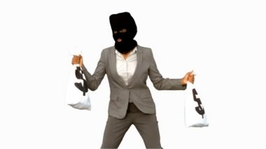 Burglar wearing balaclava and holding money bags on white screen — Stock Video
