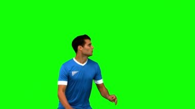 Man heading a football on green screen — Stock Video