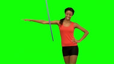 Woman working out with a hula hoop on green screen — Stock Video
