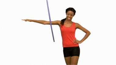 Woman working out with a hula hoop on white screen — Stock Video