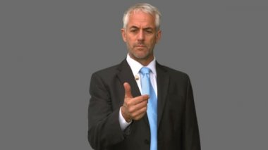 Elegant businessman throwing a dice in the air on grey screen — Stock Video