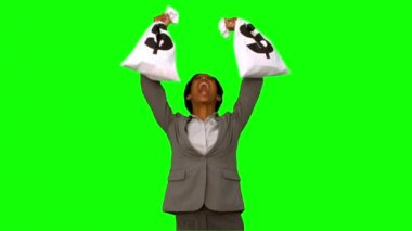 Businesswoman holding money bags on green screen — Stock Video