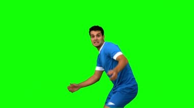 Handsome football player warming up on green screen — Stock Video