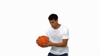 Man dribbling with a basketball on white screen — Stock Video