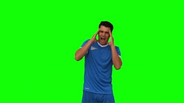 Football player suffering from headache on green screen — Stock Video