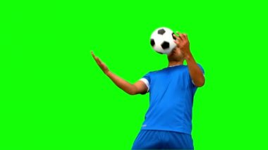 Man controlling a football with his chest on green screen — Stock Video