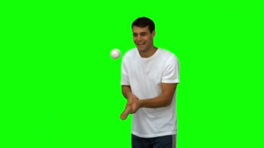 Man dribbling with a baseball on green screen — Stock Video