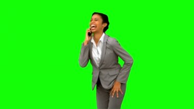 Happy businesswoman laughing while phoning on green screen — Stock Video