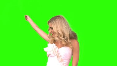 Attractive woman dancing in wedding gown on green screen — Stock Video