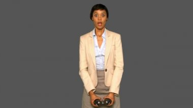 Astonished businesswoman holding binoculars — Stock Video