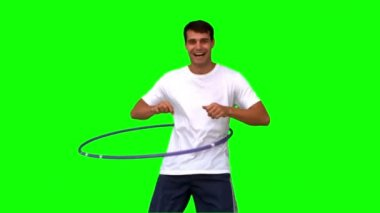 Man playing with a hula hoop on green screen — Stock Video